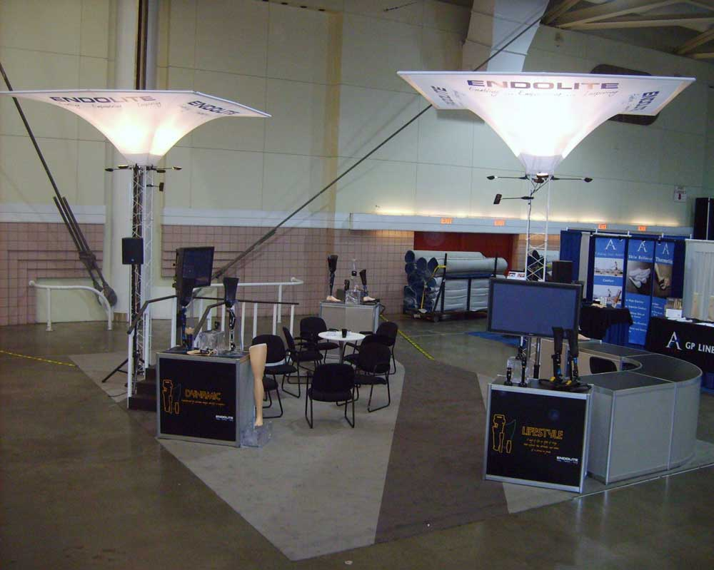 "Exhibit Rental Blatchford Rental Tension ""Funnel"" signage. Custom ramp carpet"